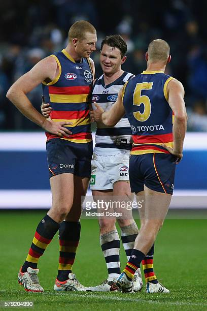 Patrick Dangerfield of the Cats catches up with Sam Jacobs of the Crows and Scott Thompson after his win during the round 18 AFL match between the...