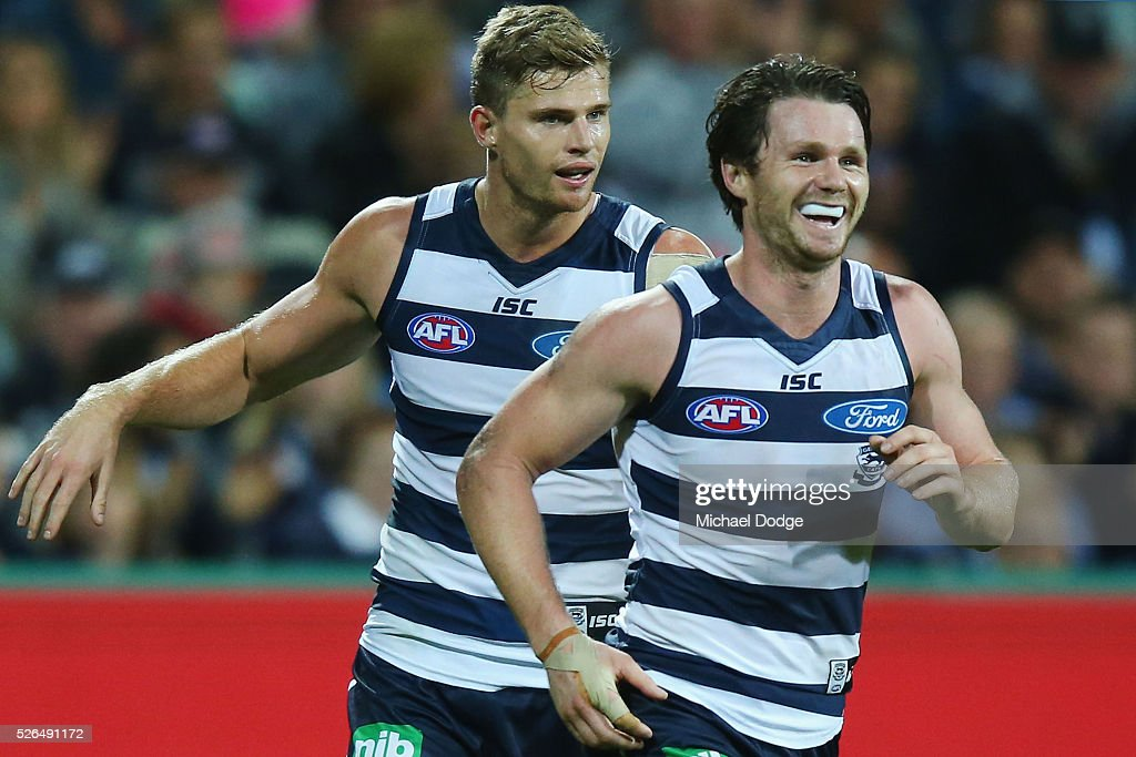 <a gi-track='captionPersonalityLinkClicked' href=/galleries/search?phrase=Patrick+Dangerfield&family=editorial&specificpeople=4479400 ng-click='$event.stopPropagation()'>Patrick Dangerfield</a> of the Cats celebrates a goal during the round six AFL match between the Geelong Cats and the Gold Coast Suns at Simonds Stadium on April 30, 2016 in Geelong, Australia.