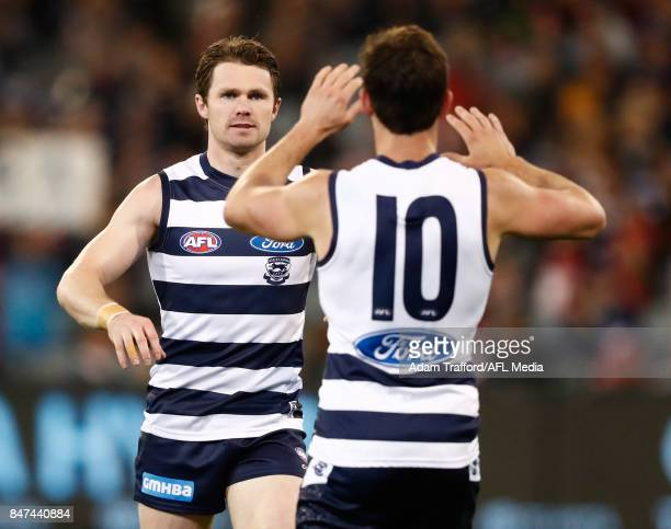 Patrick Dangerfield of the Cats celebrates a goal with Daniel Menzel of the Cats during the 2017 AFL Second Semi Final match between the Geelong Cats...