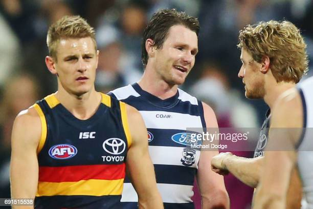 Patrick Dangerfield of the Cats celebrates the win when catching up with former teammate Rory Sloane of the Crows during the round 11 AFL match...
