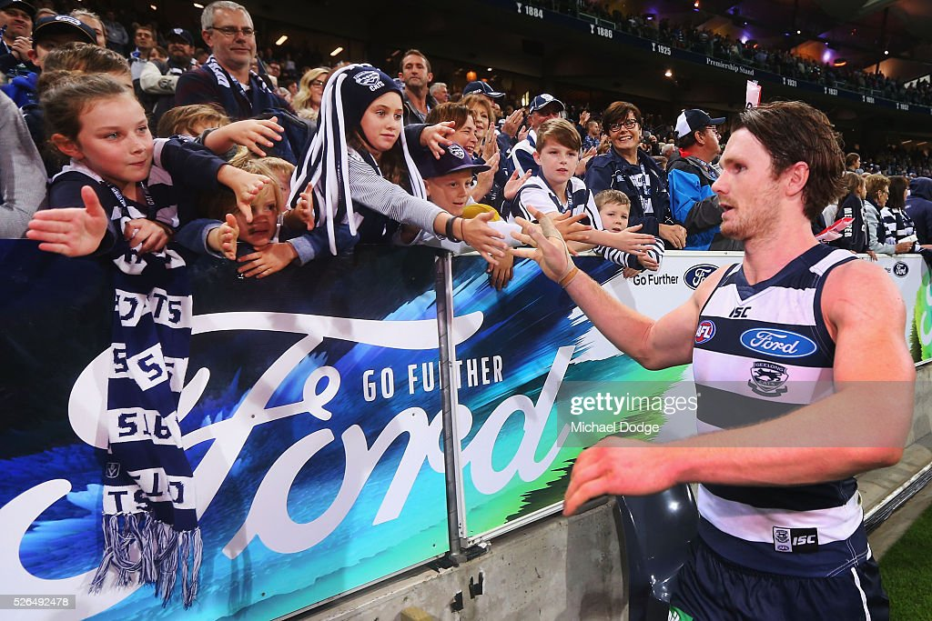 Patrick Dangerfield of the Cats celebrates the win with fans during the round six AFL match between the Geelong Cats and the Gold Coast Suns at Simonds Stadium on April 30, 2016 in Geelong, Australia.