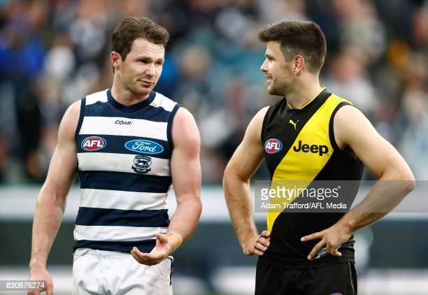 Patrick Dangerfield of the Cats chats to Trent Cotchin of the Tigers during the 2017 AFL round 21 match between the Geelong Cats and the Richmond...