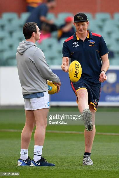 Patrick Dangerfield of the Cats chats with Sam Jacobs of the Crows prior to the First AFL Preliminary Final match between the Adelaide Crows and the...