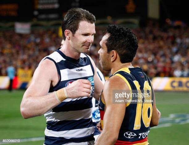 Patrick Dangerfield of the Cats congratulates former Crows teammate Eddie Betts of the Crows during the 2017 AFL First Preliminary Final match...