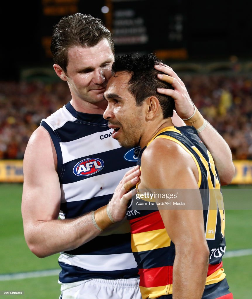 Patrick Dangerfield of the Cats congratulates former Crows teammate Eddie Betts of the Crows during the 2017 AFL First Preliminary Final match between the Adelaide Crows and the Geelong Cats at Adelaide Oval on September 22, 2017 in Adelaide, Australia.