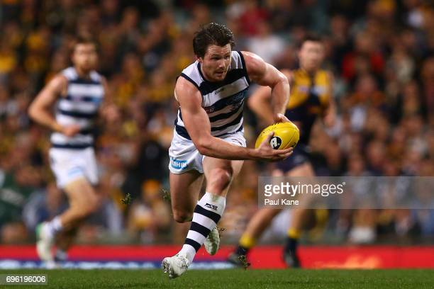 Patrick Dangerfield of the Cats gathers the ball during the round 13 AFL match between the West Coast Eagles and the Geelong Cats at Domain Stadium...