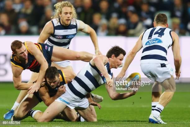 Patrick Dangerfield of the Cats handballs to Joel Selwood of the Cats during the round 11 AFL match between the Geelong Cats and the Adelaide Crows...