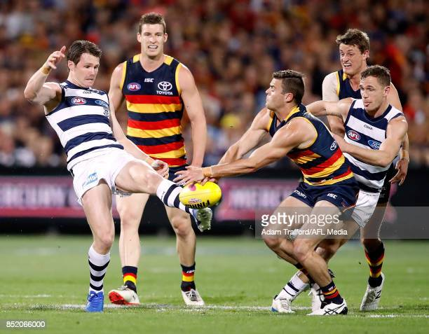 Patrick Dangerfield of the Cats has his kick smothered by Brad Crouch of the Crows during the 2017 AFL First Preliminary Final match between the...