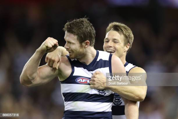 Patrick Dangerfield of the Cats is congratulated by his teammates after kicking a goal during the round three AFL match between the Geelong Cats and...