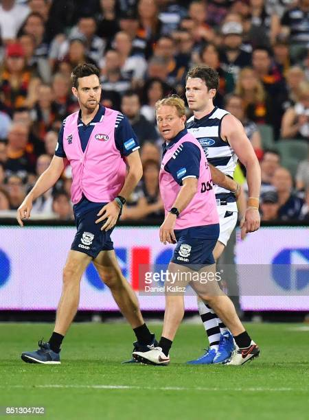 Patrick Dangerfield of the Cats is helped from the ground after colliding with Rory Sloane of the Crows during the First AFL Preliminary Final match...