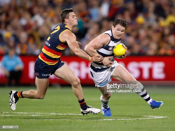 Patrick Dangerfield of the Cats is tackled by Brad Crouch of the Crows during the 2017 AFL First Preliminary Final match between the Adelaide Crows...