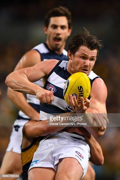 Patrick Dangerfield of the Cats is tackled by Elliot Yeo of the Eagles during the 2017 AFL round 13 match between the West Coast Eagles and the...