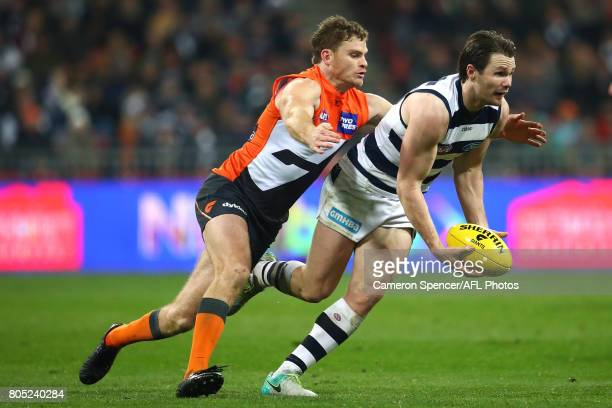 Patrick Dangerfield of the Cats is tackled by Heath Shaw of the Giants during the round 15 AFL match between the Greater Western Sydney Giants and...