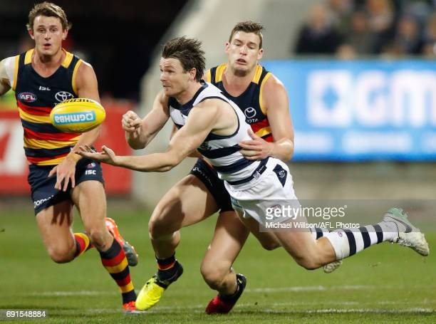 Patrick Dangerfield of the Cats is tackled by Josh Jenkins of the Crows during the 2017 AFL round 11 match between the Geelong Cats and the Adelaide...