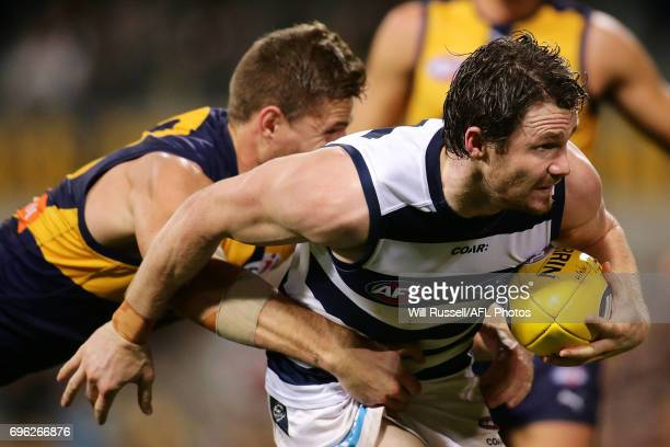 Patrick Dangerfield of the Cats is tackled by Nathan Vardy of the Eagles during the round 13 AFL match between the West Coast Eagles and the Geelong...