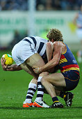 Patrick Dangerfield of the Cats is tackled by Rory Sloane of the Crows during the round 18 AFL match between the Geelong Cats and the Adelaide Crows...