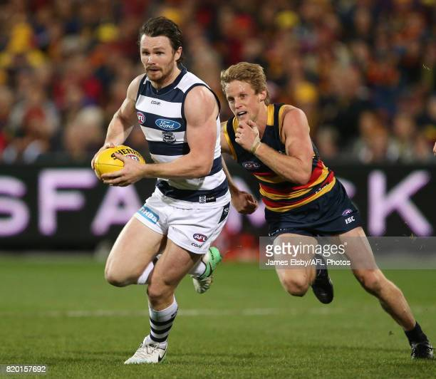 Patrick Dangerfield of the Cats is tackled by Rory Sloane of the Crows during the 2017 AFL round 18 match between the Adelaide Crows and the Geelong...