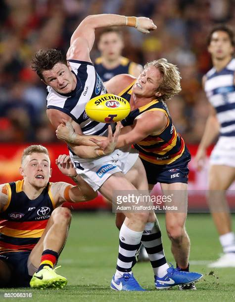 Patrick Dangerfield of the Cats is tackled by Rory Sloane of the Crows during the 2017 AFL First Preliminary Final match between the Adelaide Crows...