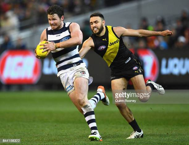Patrick Dangerfield of the Cats is tackled by Shane Edwards of the Tigers during the AFL Second Qualifying Final Match between the Geelong Cats and...