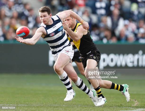Patrick Dangerfield of the Cats is tackled by Trent Cotchin of the Tigers during the 2017 AFL round 21 match between the Geelong Cats and the...