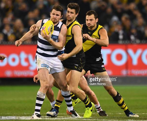 Patrick Dangerfield of the Cats is tackled by Trent Cotchin of the Tigers during the AFL Second Qualifying Final Match between the Geelong Cats and...