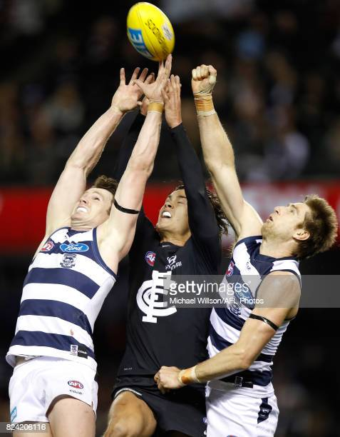 Patrick Dangerfield of the Cats Jack Silvagni of the Blues and Tom Lonergan of the Cats compete for the ball during the 2017 AFL round 19 match...