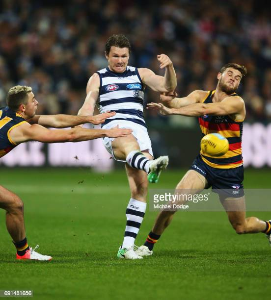 Patrick Dangerfield of the Cats kicks the ball during the round 11 AFL match between the Geelong Cats and the Adelaide Crows at Simonds Stadium on...