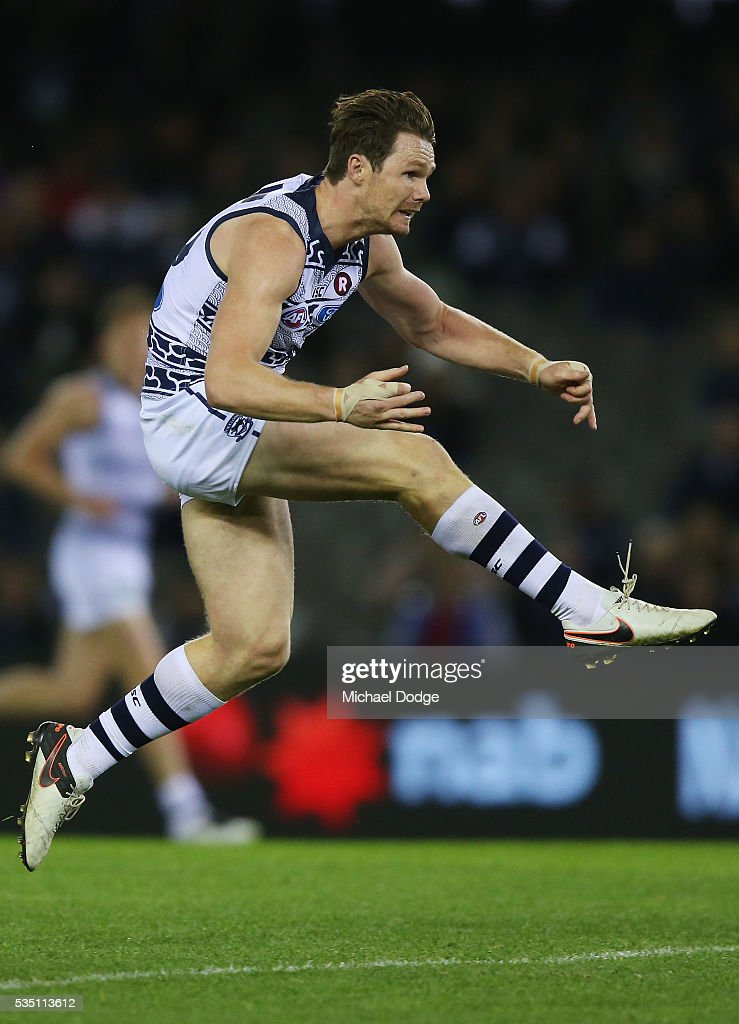 <a gi-track='captionPersonalityLinkClicked' href=/galleries/search?phrase=Patrick+Dangerfield&family=editorial&specificpeople=4479400 ng-click='$event.stopPropagation()'>Patrick Dangerfield</a> of the Cats kicks the ball for a point during the round 10 AFL match between the Carlton Blues and the Geelong Cats at Etihad Stadium on May 29, 2016 in Melbourne, Australia.