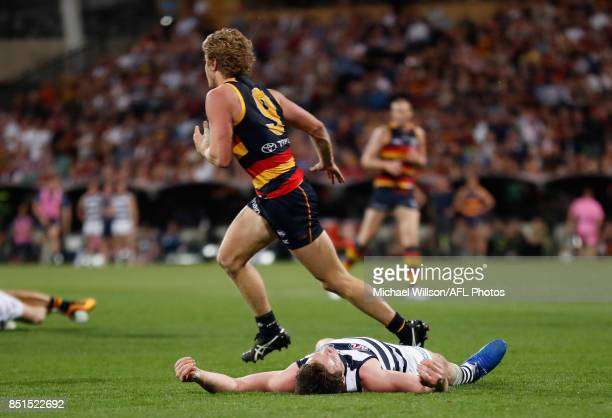 Patrick Dangerfield of the Cats lays injured after a collision with Rory Sloane of the Crows during the 2017 AFL First Preliminary Final match...