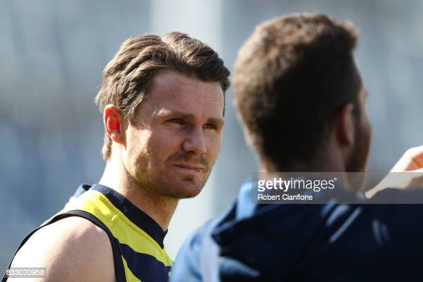 Patrick Dangerfield of the Cats looks on during a Geelong Cats AFL training session at Simonds Stadium on August 17 2017 in Geelong Australia