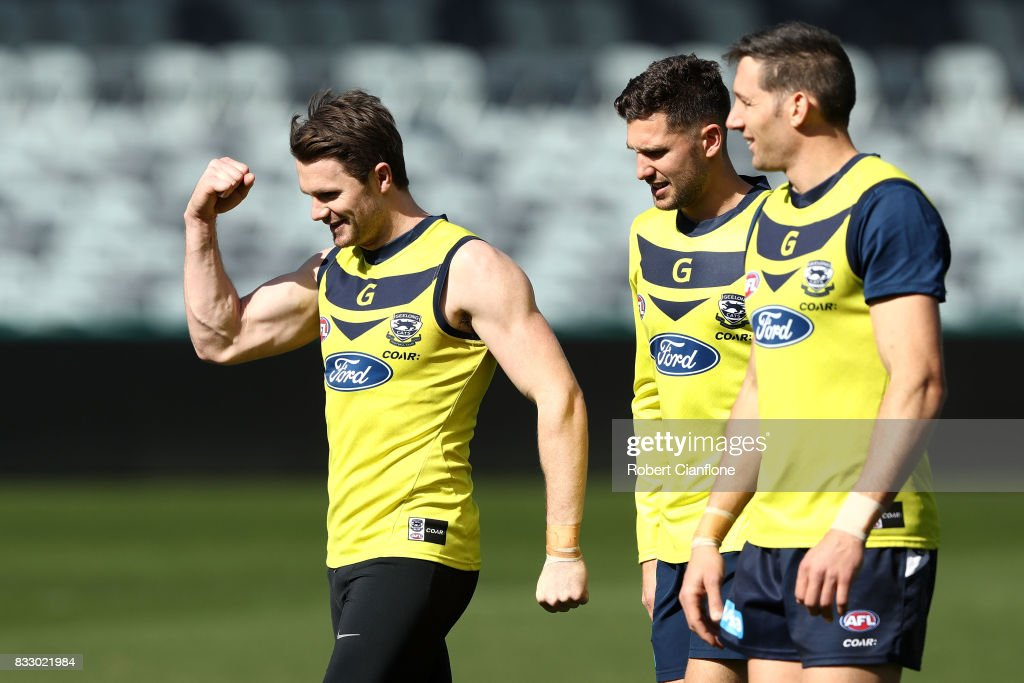 Patrick Dangerfield (L) of the Cats looks on during a Geelong Cats AFL training session at Simonds Stadium on August 17, 2017 in Geelong, Australia.