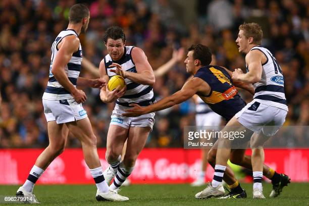 Patrick Dangerfield of the Cats looks to avoid being tackled by Dom Sheed of the Eagles during the round 13 AFL match between the West Coast Eagles...
