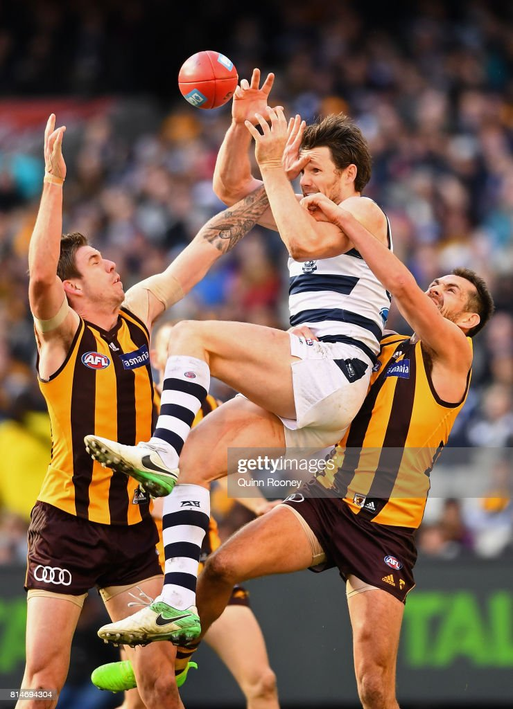Patrick Dangerfield of the Cats marks over the top of Luke Hodge of the Hawks during the round 17 AFL match between the Geelong Cats and the Hawthorn Hawks at Melbourne Cricket Ground on July 15, 2017 in Melbourne, Australia.