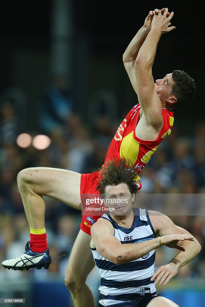 <a gi-track='captionPersonalityLinkClicked' href=/galleries/search?phrase=Patrick+Dangerfield&family=editorial&specificpeople=4479400 ng-click='$event.stopPropagation()'>Patrick Dangerfield</a> of the Cats reacts after being hit in the head from a contest with Henry Schade of the Suns during the round six AFL match between the Geelong Cats and the Gold Coast Suns at Simonds Stadium on April 30, 2016 in Geelong, Australia.