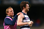 Patrick Dangerfield of the Cats recieves attention to a shoulder injury during the round 17 AFL match between the Fremantle Dockers and the Geelong...