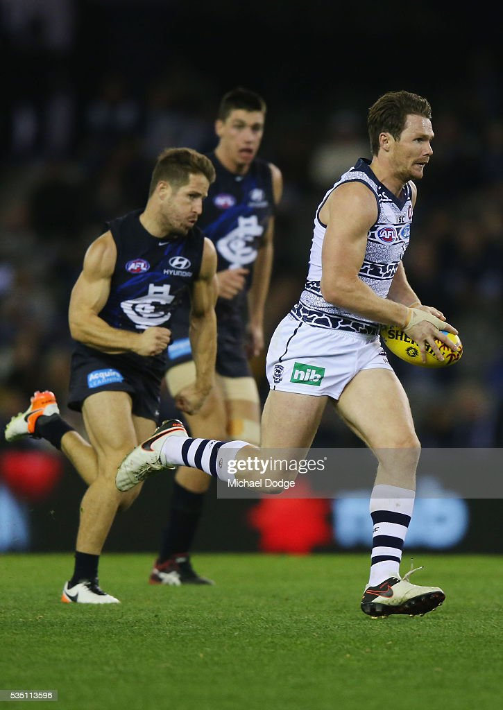 <a gi-track='captionPersonalityLinkClicked' href=/galleries/search?phrase=Patrick+Dangerfield&family=editorial&specificpeople=4479400 ng-click='$event.stopPropagation()'>Patrick Dangerfield</a> of the Cats runs with the ball during the round 10 AFL match between the Carlton Blues and the Geelong Cats at Etihad Stadium on May 29, 2016 in Melbourne, Australia.