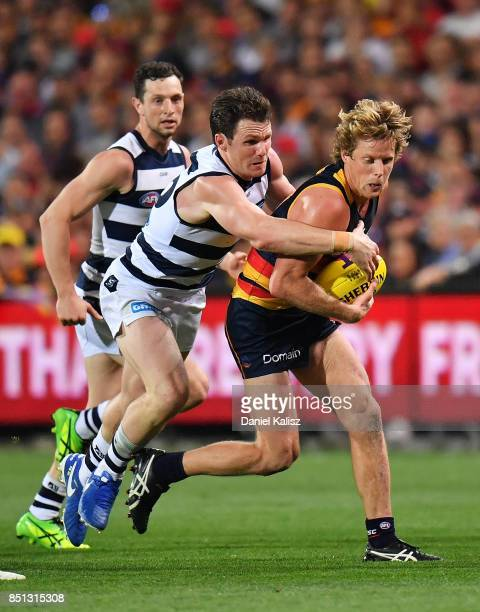 Patrick Dangerfield of the Cats tackles Rory Sloane of the Crows during the First AFL Preliminary Final match between the Adelaide Crows and the...