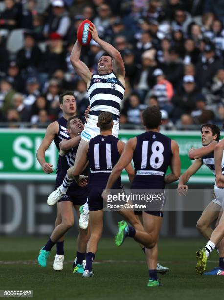 Patrick Dangerfield of the Cats takes a mark during the round 14 AFL match between the Geelong Cats and the Fremantle Dockers at Simonds Stadium on...