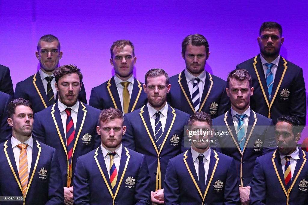 Patrick Dangerfield of the Cats, Tom Mitchell of the Hawks, Paddy Ryder of the Power, Dustin Martin of the Tigers, Eddie Betts of the Crows and the AFL All Australian team pose on stage during the AFL All Australian team announcement at the Palais Theatre on August 30, 2017 in Melbourne, Australia.