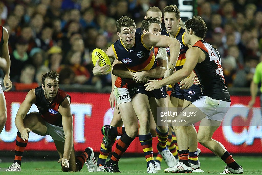 Patrick Dangerfield of the Crows is tackled during the round one AFL match between the Adelaide Crows and the Essendon Bombers at AAMI Stadium on March 22, 2013 in Adelaide, Australia.