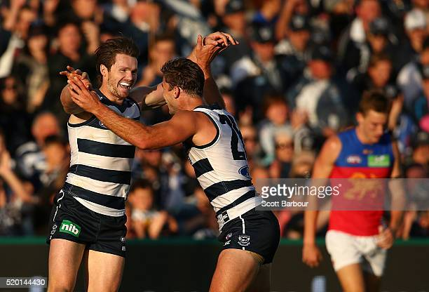 Patrick Dangerfield of the Geelong Cats celebrates after kicking his first goal with Tom Hawkins of the Geelong Cats during the round three AFL match...