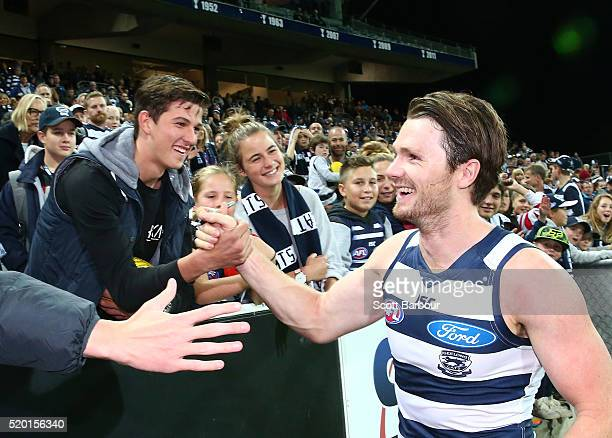 Patrick Dangerfield of the Geelong Cats celebrates with fans in the crowd after winning the round three AFL match between the Geelong Cats and the...