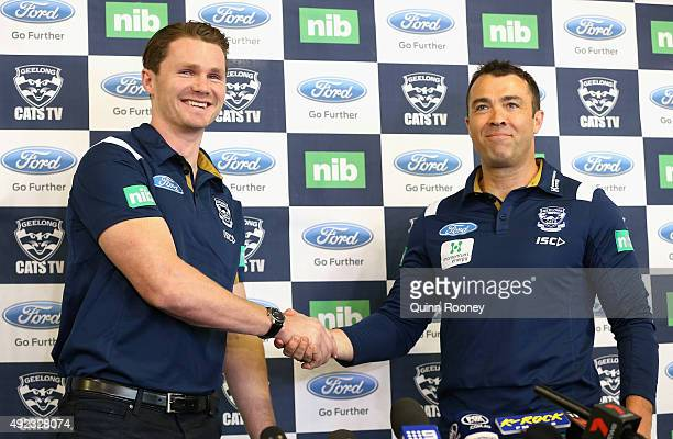 Patrick Dangerfield shakes hands with Chris Scott the coach of the Cats speak to the media during a Geelong Cats AFL press conference at Simonds...