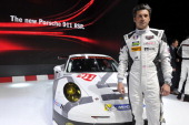 Patrick Dempsey unveils the Porsche 911 GT3 RSR as his team is selected to compete in the 24 Hours of Le Mans during the press day of the 84th...