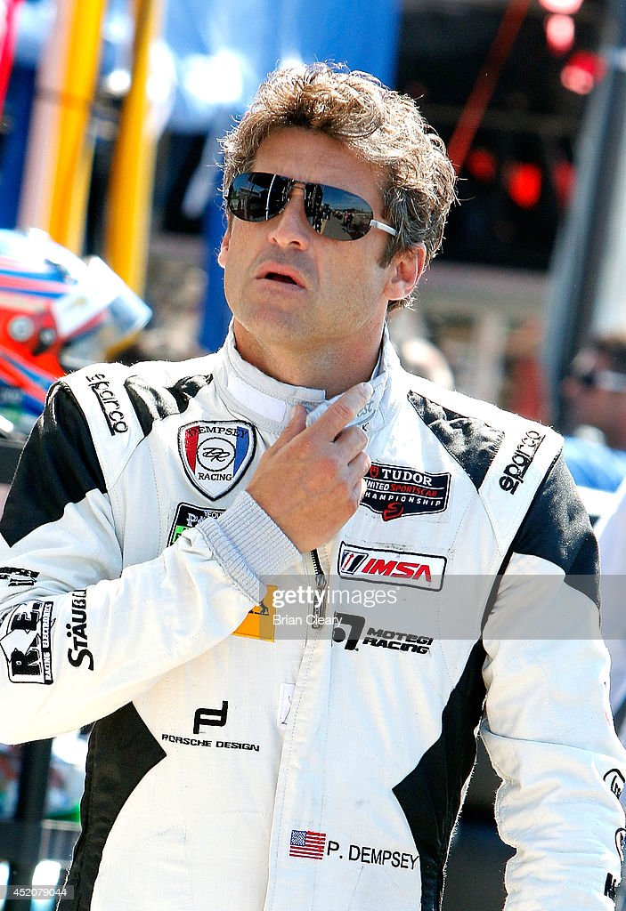 Patrick Dempsey walks through the paddock before practice for the Mobil 1 SportsCar Grand Prix at Canadian Tire Mosport Park on July 12 2014 in...