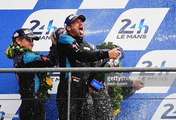 Patrick Demsey of DempseyProton Racing celebrates with codrivers Patrick Long and Marco Seefried after 2nd place in LMGTAM the Le Mans 24 Hour race...