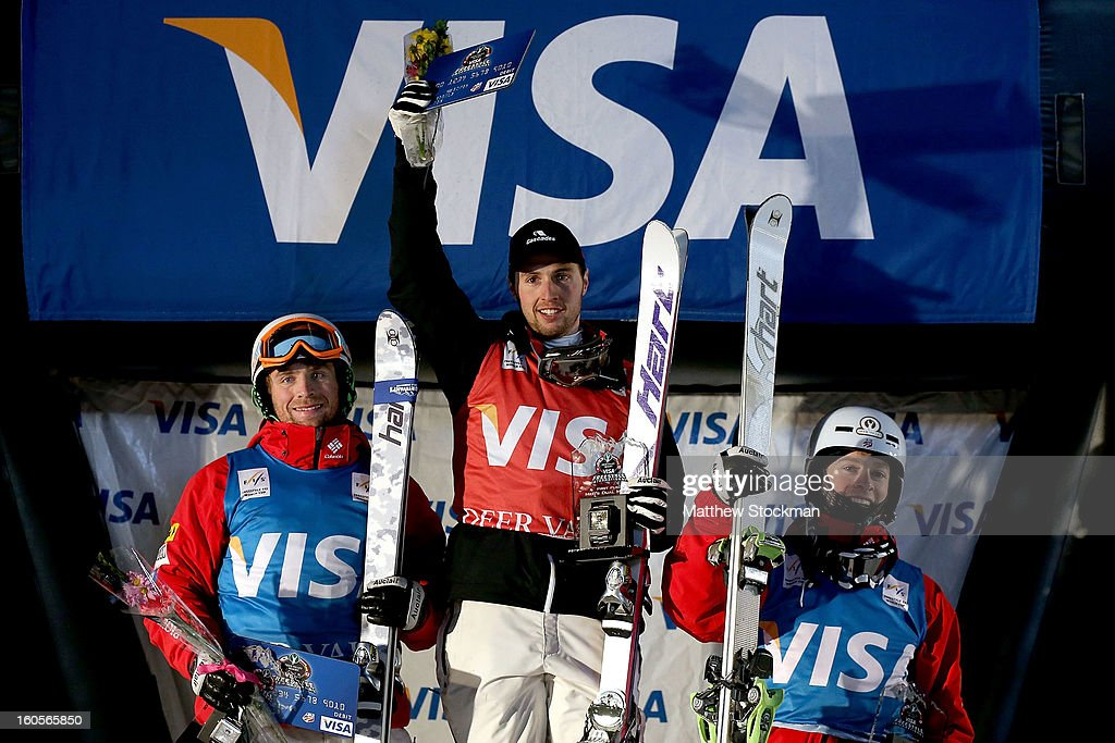 Patrick Deneen #3 in second place, Alex Bilodeau #2 of Canada in first place and Bradley Wilson #9 in third place pose for photographers on the winners podium after the Mens Dual Moguls during the Visa Freestyle International at Deer Valley on February 2, 2013 in Park City, Utah.