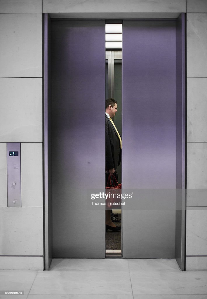 Patrick Doering, general secretary of the Free Democratic Party (FDP) stand in the elevator after the last Party parliamentary group's meeting of German Free Democrats (FDP) at the lower house of parliament Bundestag on October 08, 2013 in Berlin Germany,