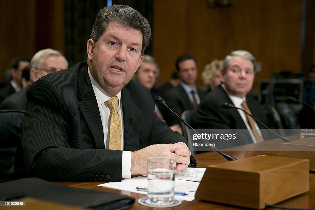 Patrick Donahoe, postmaster general and chief executive officer of the U.S. Postal Service (USPS), left, speaks during a Senate Homeland Security and Governmental Affairs Committee hearing with Eugene Dodaro, comptroller general of the United States and head of the Government Accountability Office, in Washington, D.C., U.S., on Wednesday, Feb. 12, 2013. The U.S. Postal Service, which lost $1.3 billion in its first quarter, said its debt could reach $45 billion by around 2017 if Congress doesn't pass legislation allowing it to change its business model. Photographer: Andrew Harrer/Bloomberg via Getty Images