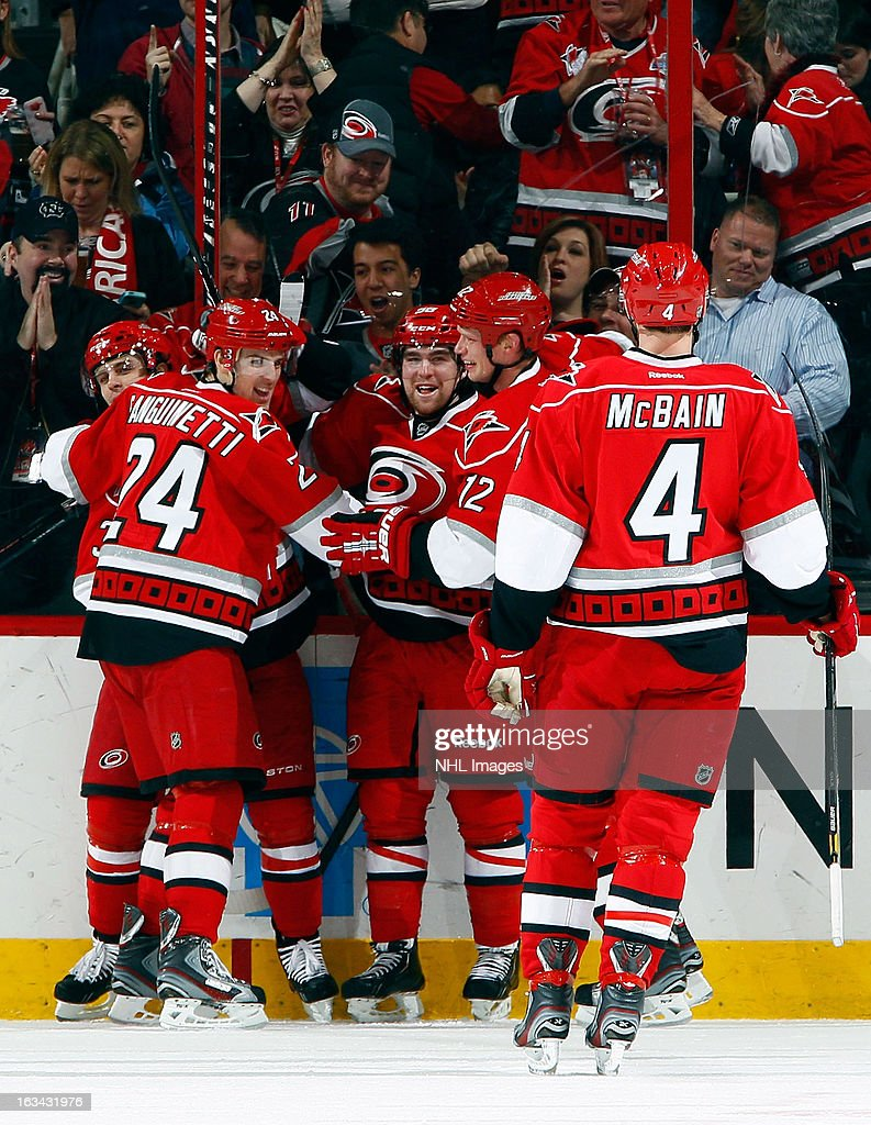 Patrick Dwyer #39, Bobby Sanguinetti #24, <a gi-track='captionPersonalityLinkClicked' href=/galleries/search?phrase=Eric+Staal&family=editorial&specificpeople=202199 ng-click='$event.stopPropagation()'>Eric Staal</a> #12 and Jamie McBain #4 of the Carolina Hurricanes congratulate teammate Chris Terry #58 on his first NHL goal in his first NHL on March 9, 2013 against the New Jersey Devils at PNC Arena in Raleigh, North Carolina.